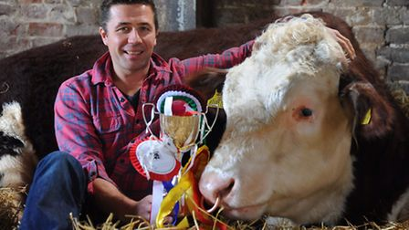 Jeremy Buxton, former TV presenter, who now farms Hereford cattle at Booton, with his prizewinning b