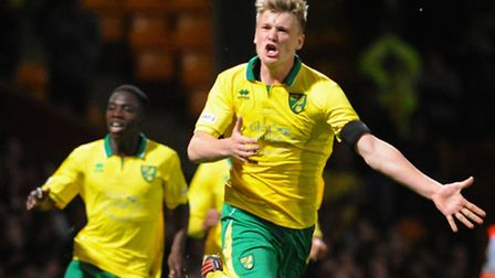 Captain Cameron McGeehan celebrates scoring the winning penalty for Norwich City in the first leg of