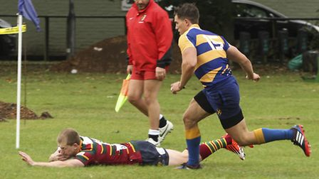 Action from Norwich's win at St Albans in the Intermediate Cup, Michael Campton-Smith scores. Pictur