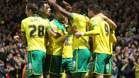 Norwich City players celebrate Cameron Jerome's first goal against Bolton. Picture: Paul Chesterton