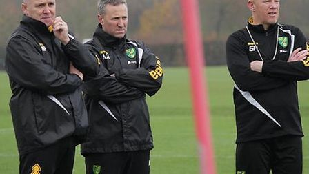 Mike Phelan gets down to work at Norwich City's Colney Training Centre with manager Neil Adams (cent