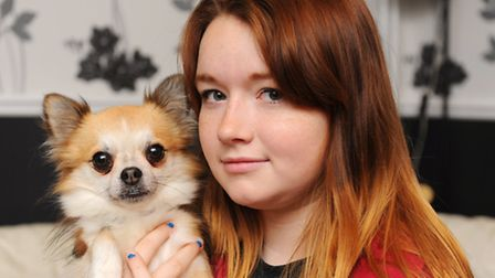 Leah Davis with their surviving dog Titch.Picture: James Bass