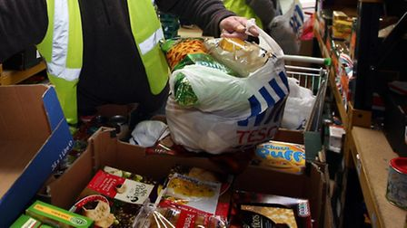 File photo dated 20/12/11 of workers at a food bank as almost a million adults and children received