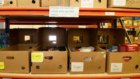 Boxes of food on shelving ready to be picked for distribution at the Bromley Borough Foodbank in Orp