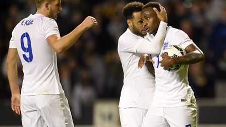 Saido Berahino (right) celebrates scoring for England Under-21s alongside Norwich City's Nathan Redm