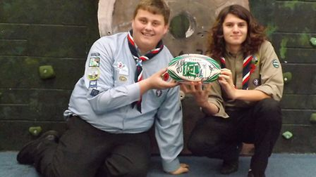 Callum Hall, left, and Harry Gillingwater with the rugby ball signed by Ben and Tom Youngs which wil