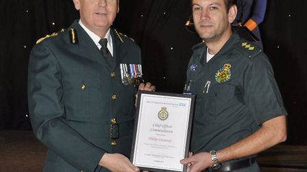 Philip Sweeney (right) receives his award from Anthony Marsh, chief executive of EEAST