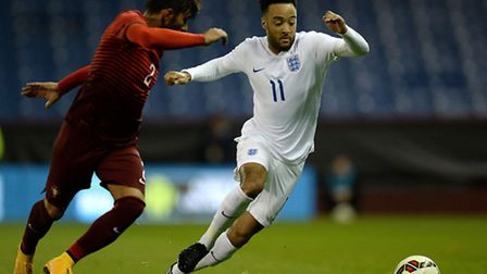 England U21's Nathan Redmond battles for the ball with Portugal U21's Ricardo Esgaio, during the Int
