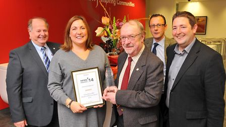 NFRN HND Retailer of the Year award winner Vicky Anderson, being presented with the award by Mr Owe