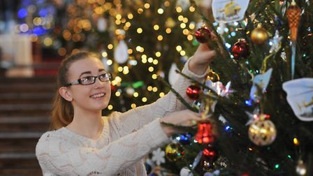 Sian Howell setting up her tree for the East Anglian Air Ambulance at the Fakenham Parish Church Chr