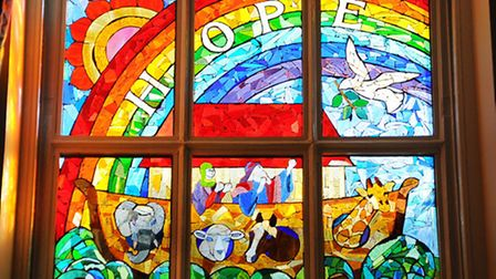 The new stained glass window at Wreningham Primary School, designed by some of the children and arti