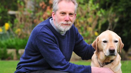 Rev John Beauchamp with his guide dog Nelson.
