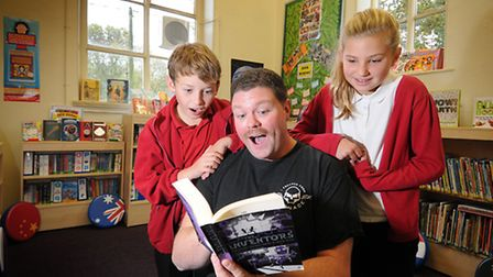 Opening of Antingham and Southrepps Primary School library. Author Alexander Gordon Smith with pupil
