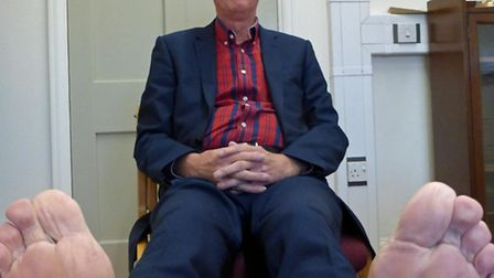 """Great Yarmouth Borough Council leader Trevor Wainwright baring his """"soles"""" ahead of the firewalk in"""