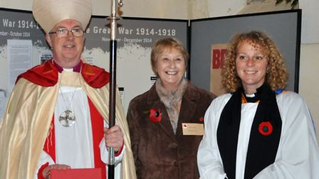 Jackie Lanaway with Bishop Graham and Rev Suzanne Cooke, Priest in Charge, with the book.