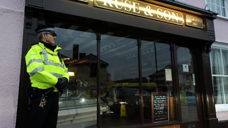 Police at Ruse & Son butchers in Long Melford after a body was discovered at a property elsewhere in