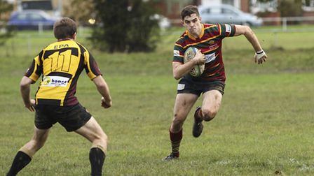 Norwich's Richie Rhodes ploughs thriugh the mud at Braintree last Saturday. Picture: Andy Micklethwa