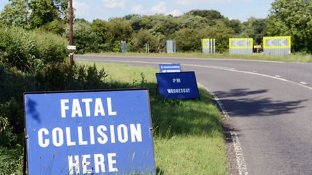 Police signs on the side of the road at the scene of the crash near Hilborough.