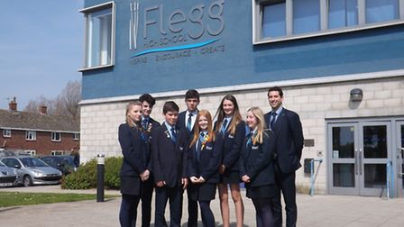 Head teacher Dr Simon Fox stands outside the modern reception with the studen leadership team as th