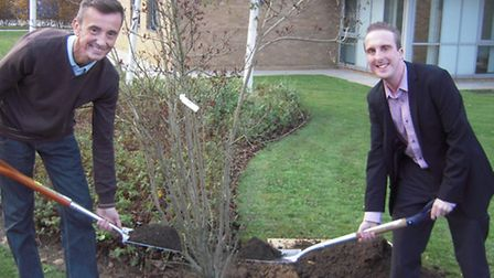 Clive Crotch (Left) and Carl Bradley (Right) planting the tree in memory of William Bradley