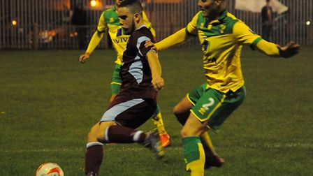 Action from Thetford Town V NCFC U21s. Cameron Norman, front, for Norwich, and Bruno Tavares for The
