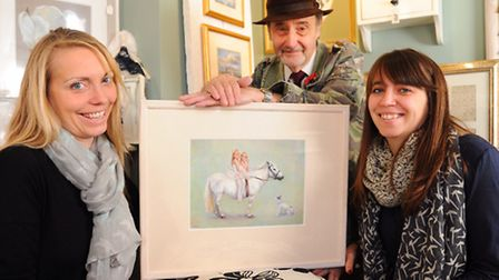 Rebecca Appleton, left, and her sister, Fiona Dye, with artist James J Allen who painted them on hor