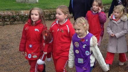 A trio of Aylsham Rainbows make their way to church for the Remembrance Day service. Picture: ALEX H