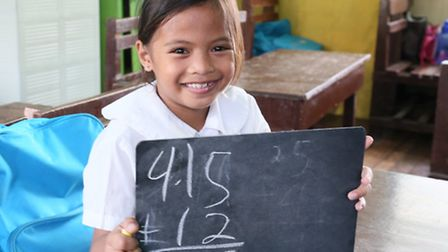 Althea Jane, aged eight, in class at Kapangian Central School in Tacloban City. The school was damag