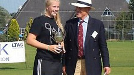 Maddie Brooks is presented with her trophy after winning the ladies singles at the Framlingham Junio