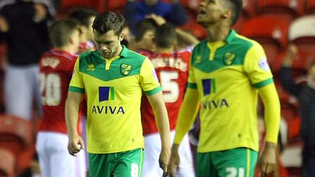 Norwich City's players react as Grant Leadbitter celebrates scoring Middlesbrough's third goal on Tu