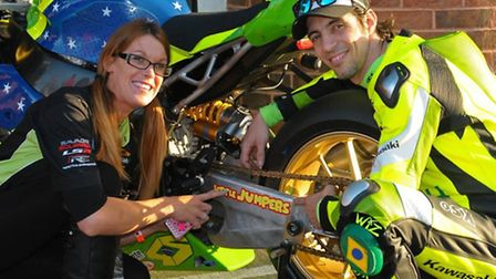 Faye Denney with British Superbike rider Rhalf Lo Turco and his bike sponsored by Little Jumpers.
