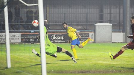 Stephen Spriggs tucked home his second. Picture: Ian Burt