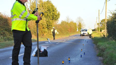Police investigate the fatal road accident near Scoulton where one person died. Picture by SIMON FIN