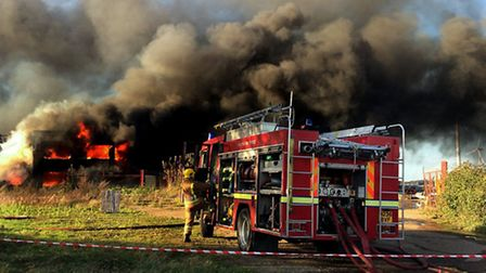 The warehouse was engulfed in flames before fire crews arrived. Picture: Stephen Huntley/BBC