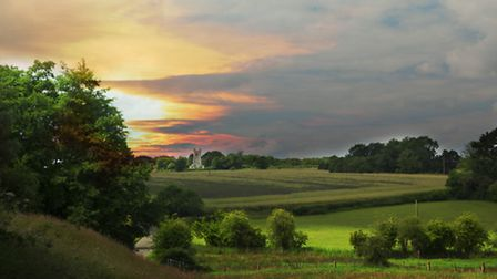 View over fields to All Saints and St Mary's Church. Photo: Steven Austin.