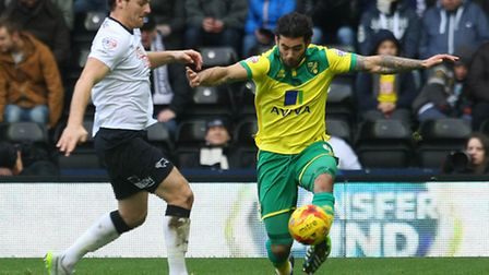 Bradley Johnson of Norwich and Chris Martin of Derby County in action during the Sky Bet Championshi