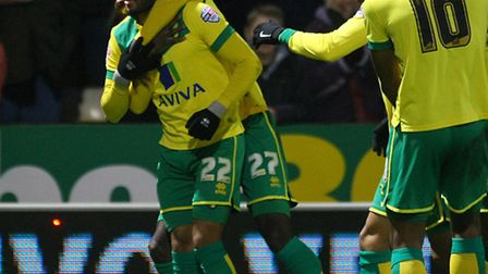 Nathan Redmond is mobbed after opening his goalscoring account for the season in Norwich City's 5-0
