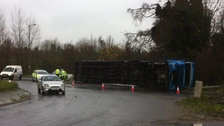 A lorry has turned over on a roundabout on the A11 near the A1075 at Thetford.