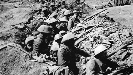 Undated file photo of British infantrymen occupying a shallow trench in a ruined landscape before an