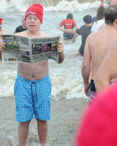 Cromer boxing day dip 2014. Geoff Buckingham from London, who travelled to Cromer to do the dip, rea