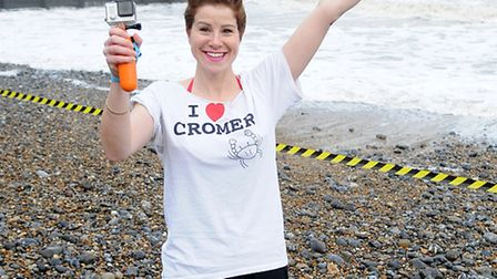 Cromer boxing day dip 2014. EDP reporter Kate Royall gets ready to do the dip with her Go-Pro camera