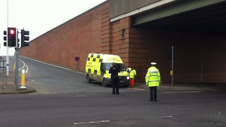 Police and highway teams at the scene of the crash in Beccles Road, Gorleston