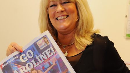 Caroline Flack's mum Chris, with the poster encouraging Strictly Come Dancing fans to vote for Carol