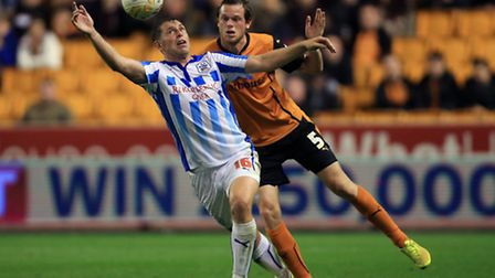 Huddersfield Town's Grant Holt (left) holds off a challenge from Wolverhampton Wanderers' Richard St