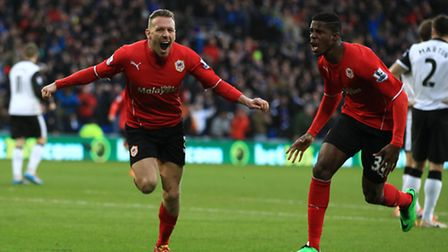 Cardiff City's Craig Bellamy (left) celebrates scoring his sides opening goal against Norwich during