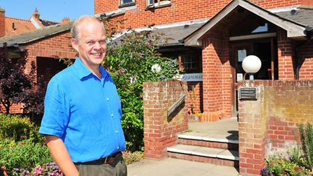 Retired GP Dr Andrew Eastaugh outside the former surgery in York Road, Southwold.