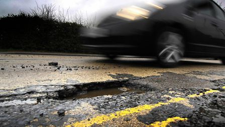 Norfolk County Council is to get nearly £29m to fix roads and fill in potholes. PHOTO: ANTONY KELLY.