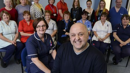 Tommy Whitelaw (front) with staff from the Queen Elizabeth Hospital after his talk about dealing wit