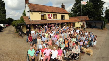 Residents of Upton celebrate outside their community owned pub the White Horse.Picture : Jeremy Durk