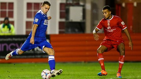 Jake Reed of Lowestoft Town (left) getsa shot away during the Conference North match at the Lamb Gr